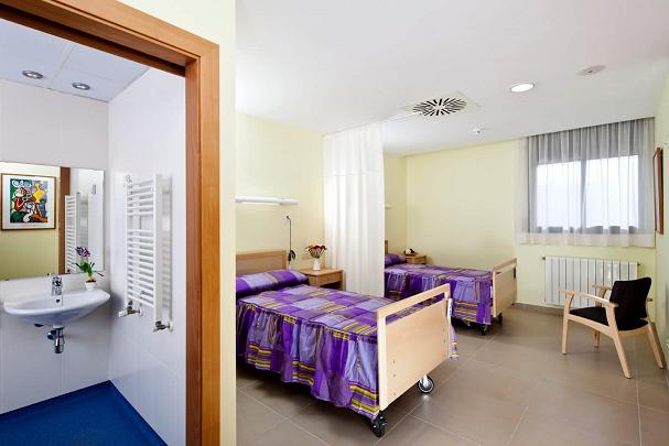 Gimnasio y habitación doble